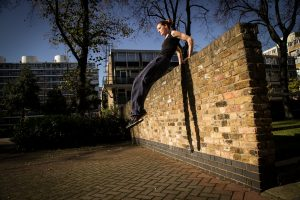 female parkour athlete vaulting
